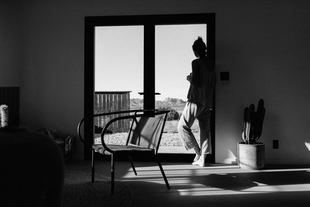 Photo of person looking out window of a home, a Private Listing